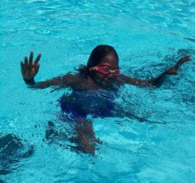 An aboriginal girl in the pool at Warmun