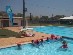 Aboriginal children in the pool at Warmun with their instructor