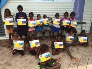 Aboriginal children holding up their Swim and Survive certificates