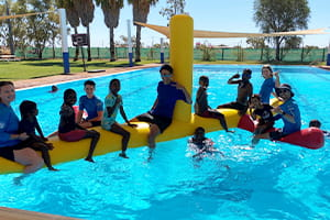 Yandeyarra children enjoying a play on an inflatable in the pool