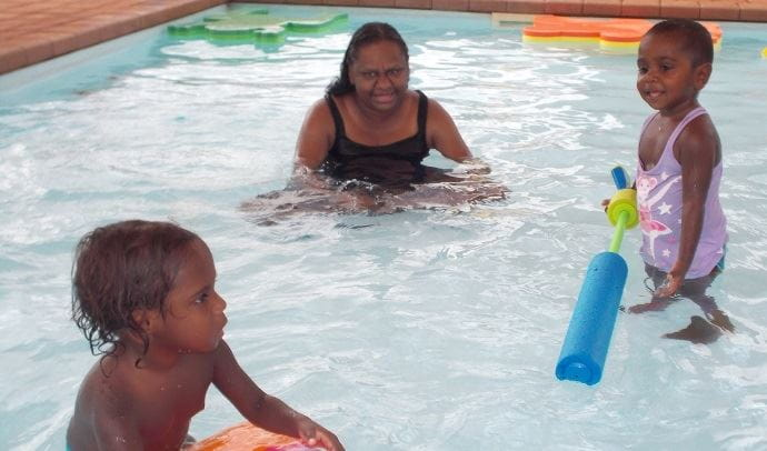 Toddlers in the pool with their mum at Yandeyarra