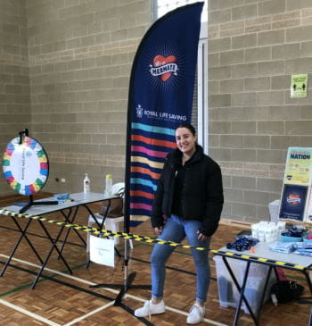 A member of our Youth Water Safety team manning a stall at a high school