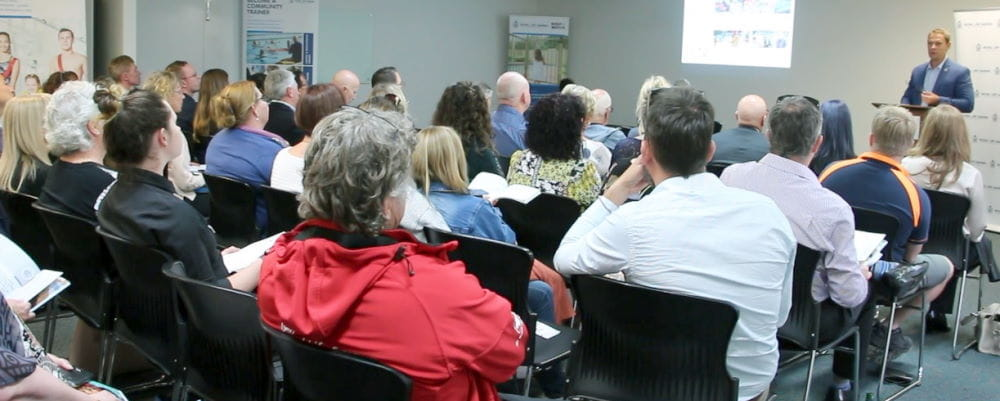 Members gathered at the AGM watching CEO Peter Leaversuch present the Annual Report
