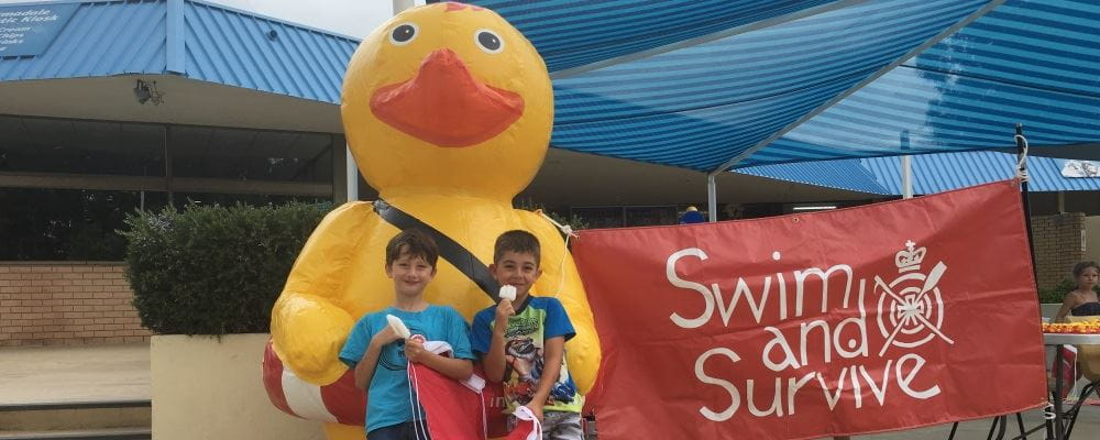 two young boys standing with inflatable Quackers at the Armadale Aquatic Centre