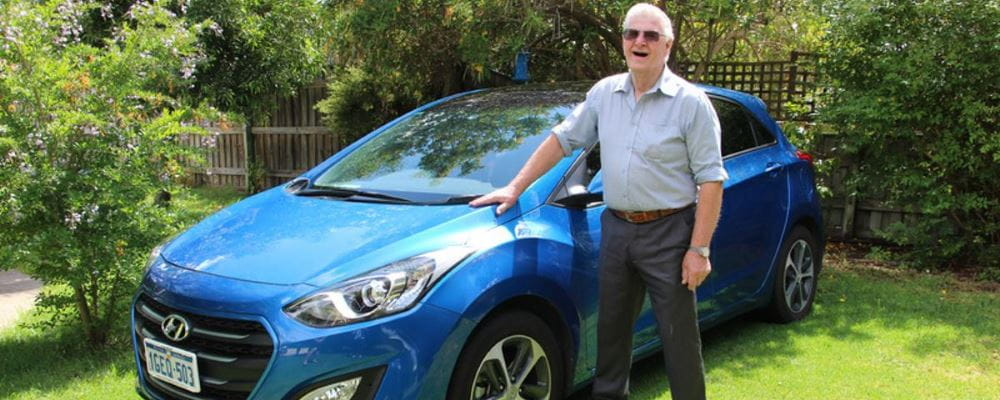 Arnold with his Hyundai i30 in his front garden