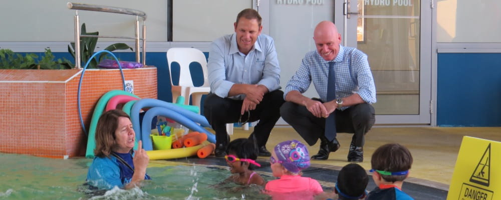 Royal Life Saving Society WA's CEO Peter Leaversuch and Sean L'Estrange MLA observe a swimming lesson at Aqualife Swim School