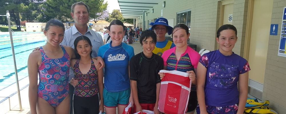Royal Life Saving Society WA CEO Peter Leaversuch with school children after their Swim and Survive lesson