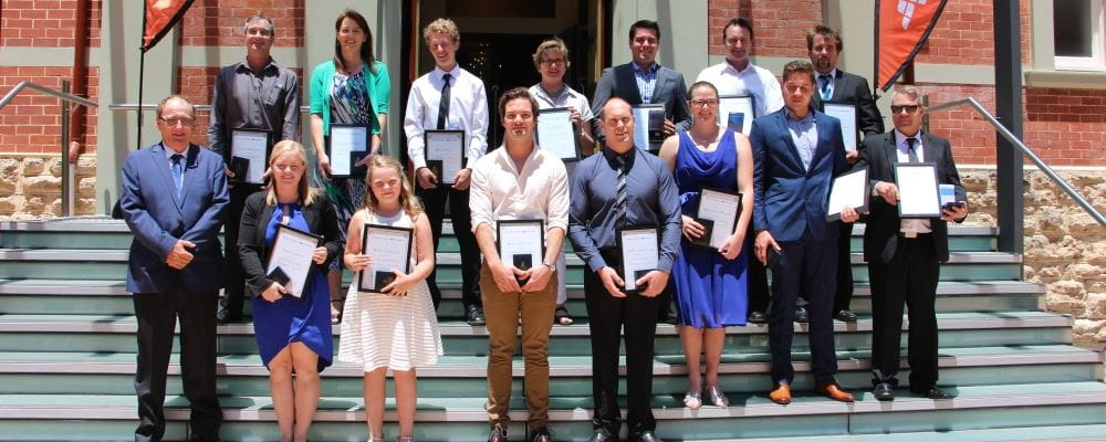 Recipients of Royal Life Saving Society Western Power Bravery Awards on the steps of Government House ballroom