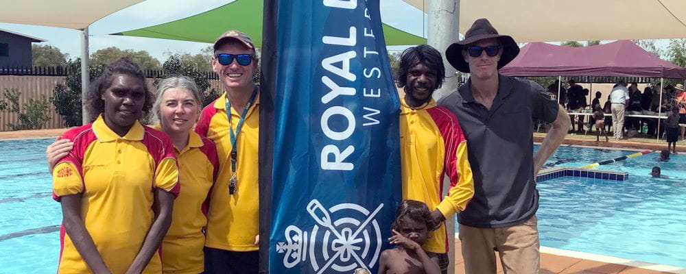Local Stephanie Chungerai, Pool Managers Bronwyn Ray and Graeme Pollett, with Local Shane Wandiga and RLSSWA's Gerg Tate by the pool at Balgo