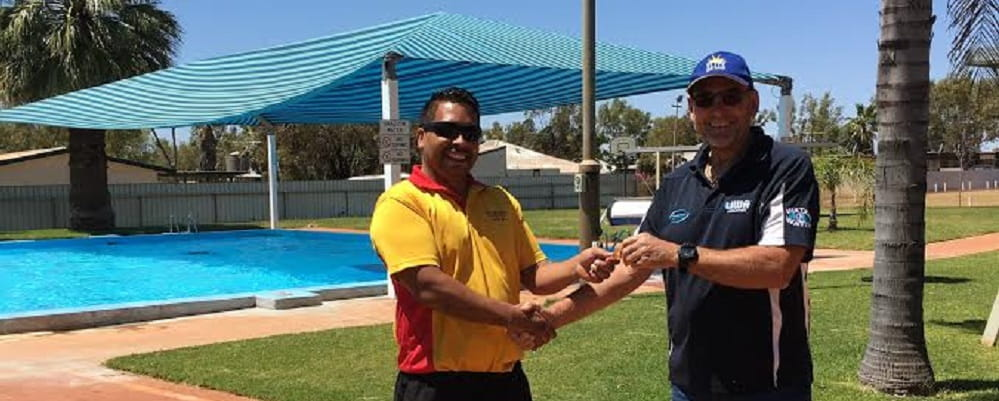 Bannister Bennell with former Laverton pool operator Ray Martin handing over the key in front of the pool