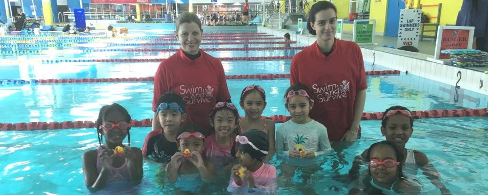 multicultural children with two swim instructors in the pool at Bayswater Waves