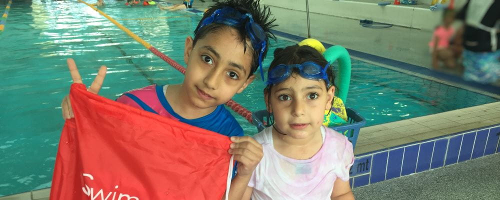 Two multicultural children by the pool at Bayswater Waves