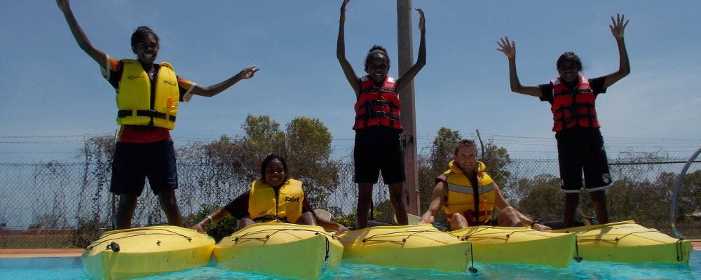 Students looking excited with their kayaks