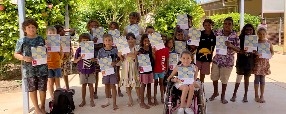 group of children from La Grange Remote Community School holding swimming certificates