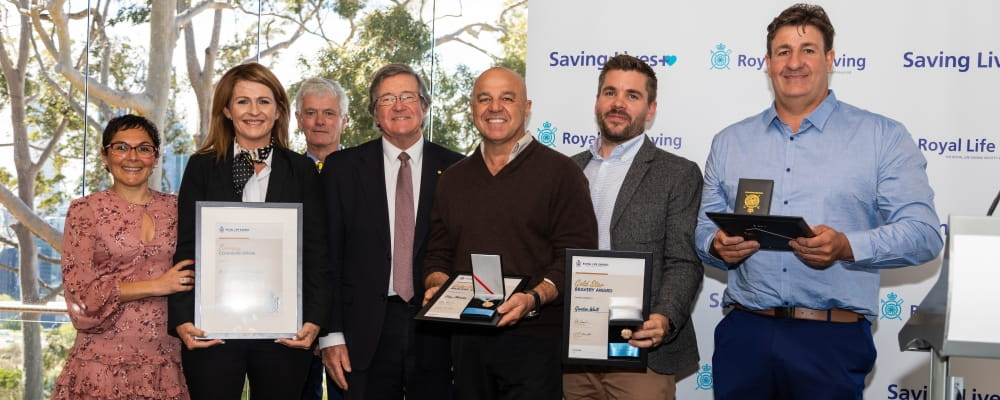 Bravery Awardees from Bristow Helicopters Australia pose with Colin Hassel and Wayne Martin AC