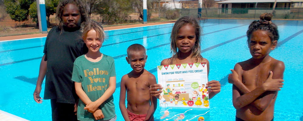 Five Burringurrah children standing in front of the local pool