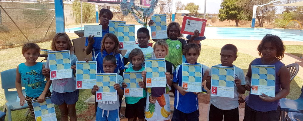 Burringurrah children with their swimming certificates at their local pool