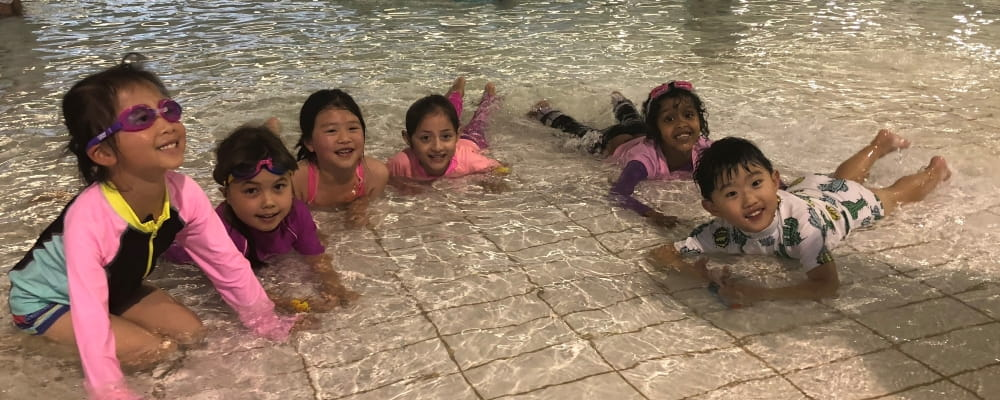 A group of kids splash about as part of the CaLD program.