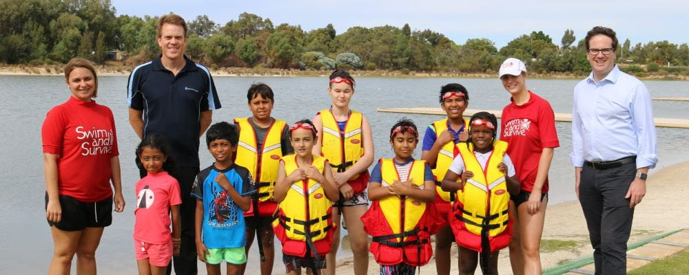 RLSSWA's Trent Hotchkin and Federal Member for Burt Matt Keogh with participants and their swim instructors at Champion Lakes
