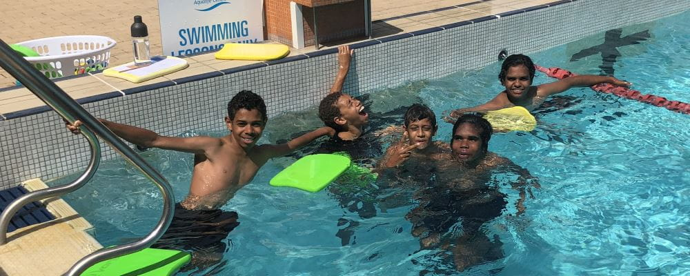Five aboriginal boys having fun in the pool as part of the Swim and Survive lessons