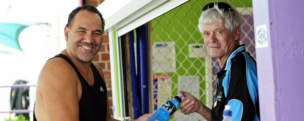 Colin Hassell (right) with a patron at one of WA's regional pools