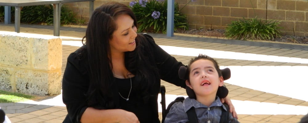image of mum Simone Soto-Flores, with son Ari, who received a Community Help Grant following his non-fatal drowning which left him with severe brain damage.
