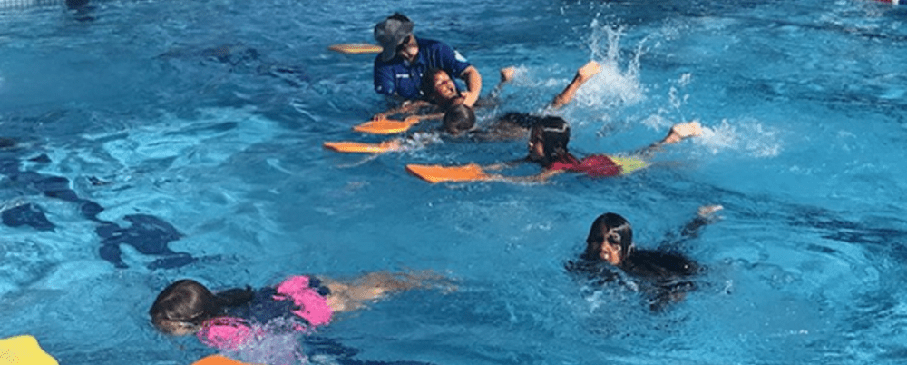 Children swimming with kickboards at Coolgardie