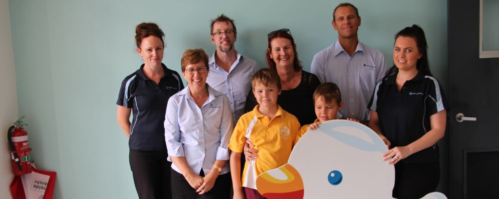 The team from Royal Life Saving WA with raffle winner Katrina and her children
