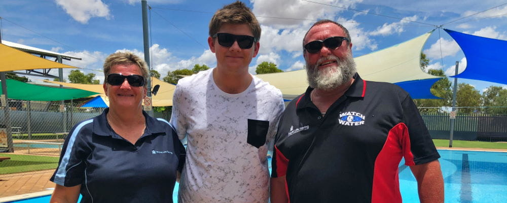 Dylan Storer with Fitzroy Crossing Pool Manager Adele and Trevor Caporn
