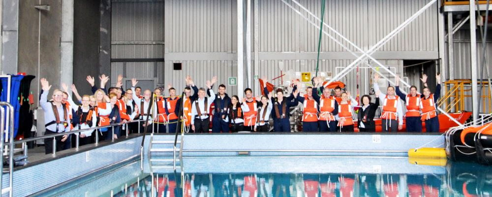 ERGT employees wearing lifejackets and standing by their training pool