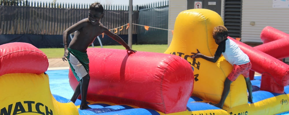 Two Aboriginal children on the pool inflatable at Fitzroy