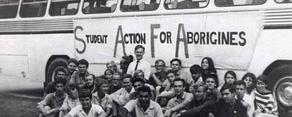 A group of people supporting Student Action For Aborigines sit near the bus they ride on as Freedom Riders
