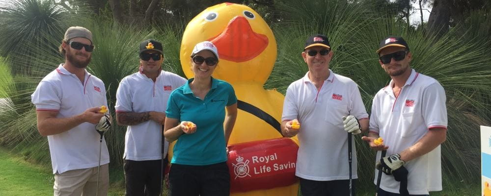 golfers gathering around our inflatable Quackers duck at the SPASA WA Golf Day