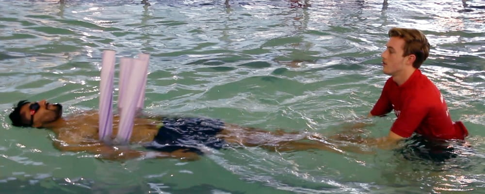 A participant in the recent Men Only Swim and Survive program swims with the support of a instructor