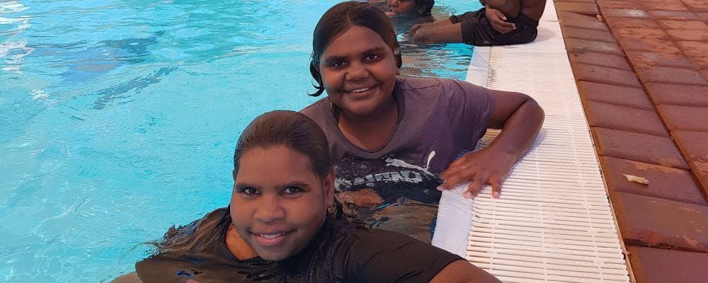 Two aboriginal children in the pool at Jigalong