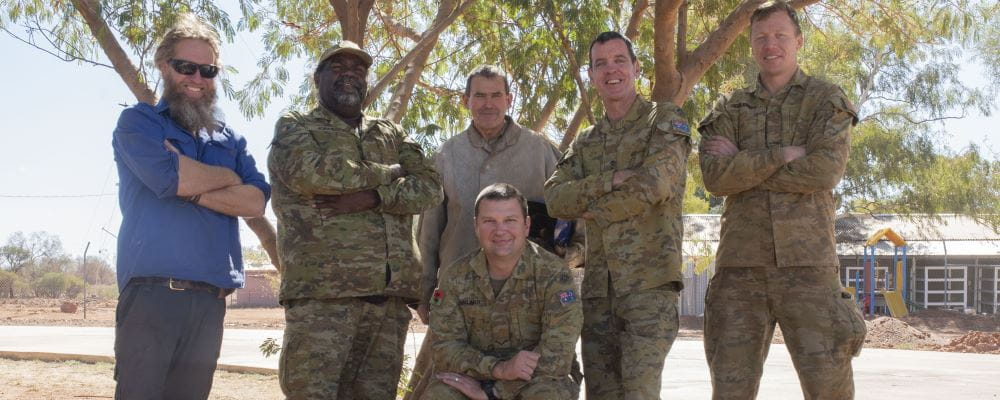 Ryan (Jigalong Shed Manager), Jigalong local and Army Reservist Darryl 'DJ' Jones alongside AACAP personnel Stewy, Capt Brendan Fox, Chris and Nathan (seated).