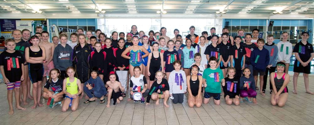 A group of Junior Lifeguard Club members gathering together by the pool at HBF Arena Joondalup