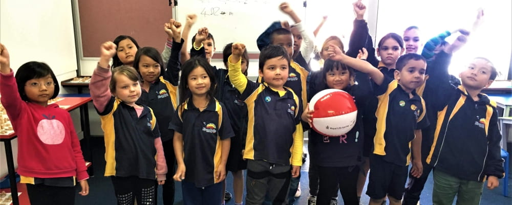 A group of kids at Koondoola primary celebrate learning  about swimming safety