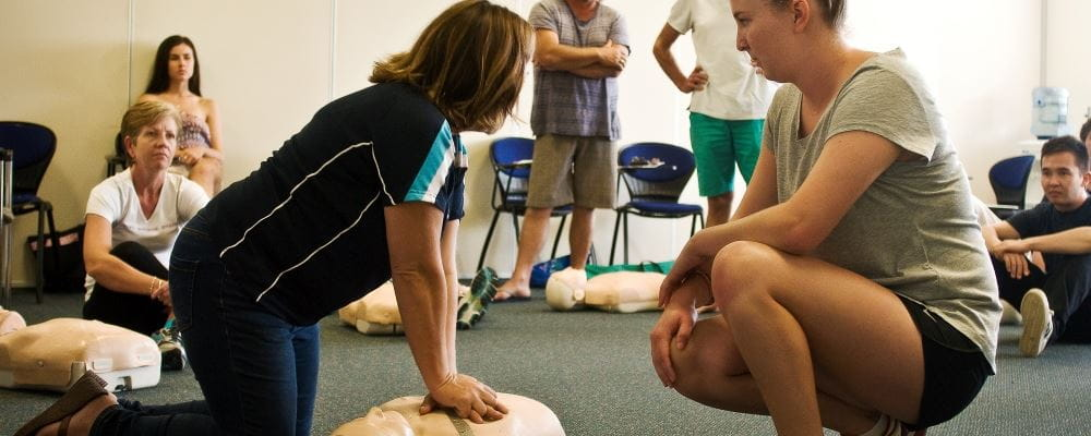 image of trainer teaching a class CPR