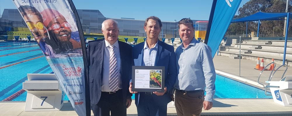 Sports Minister Mick Murray with RLSSWA CEO Peter Leaversuch and Lotterywest grant Development Officer Wayde McLean by the pool at HBF Stadium