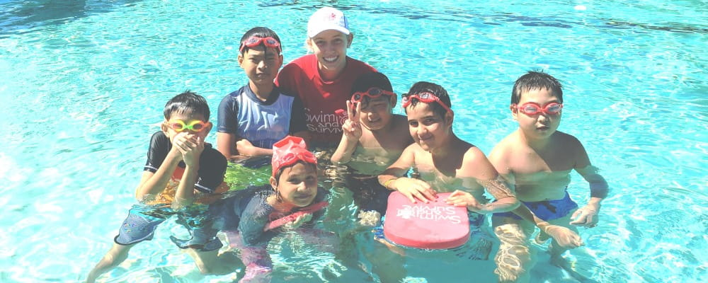 Lynwood children with a swim instructor in the pool