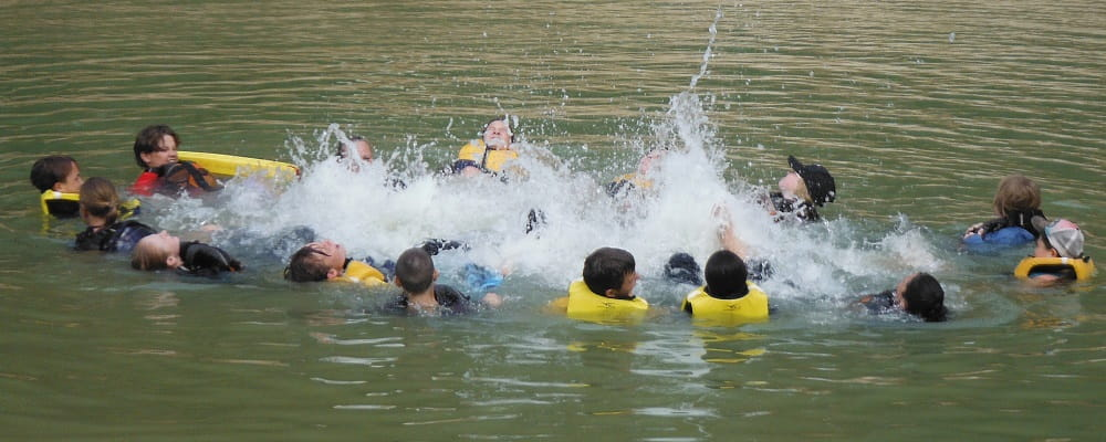 group of cadets swimming in a circle in at Serpentine Dam