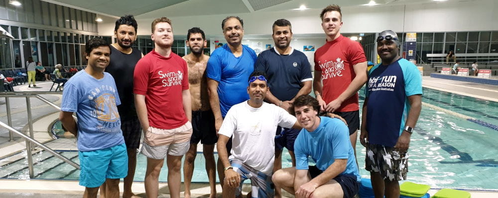 A group of men with their swim instructors by the pool at Cannington Leisureplex