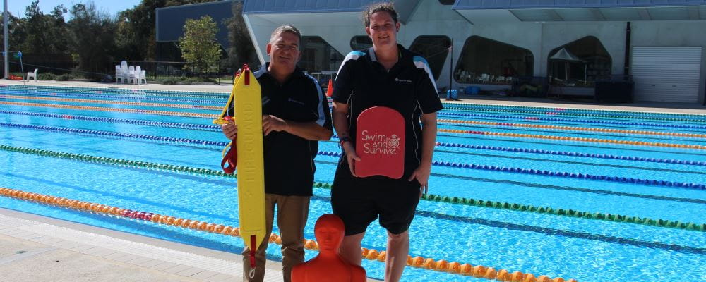 David Lucas and Mel Warren by the pool at HBF Stadium holding rescue gear