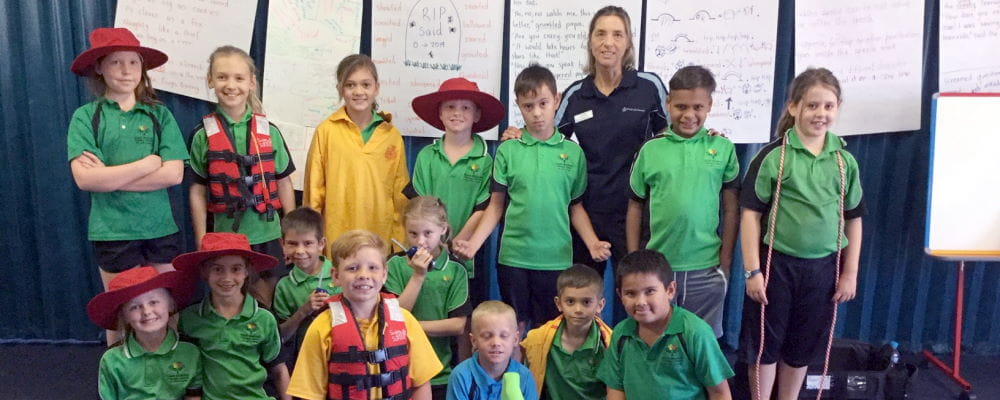 Newman school children with RLSSWA's Jacqui Forbes during their water safety talk