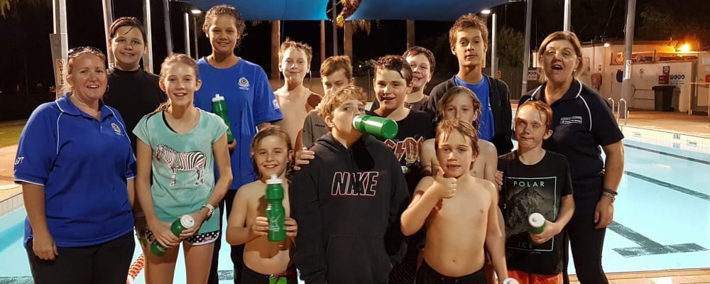 Several kids celebrate the launch of the Junior Lifeguard Club at Pannawonica Pool