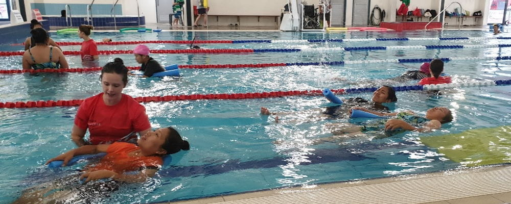 A swim instructor with multicultural women in the pool at Swan Active Ballajura
