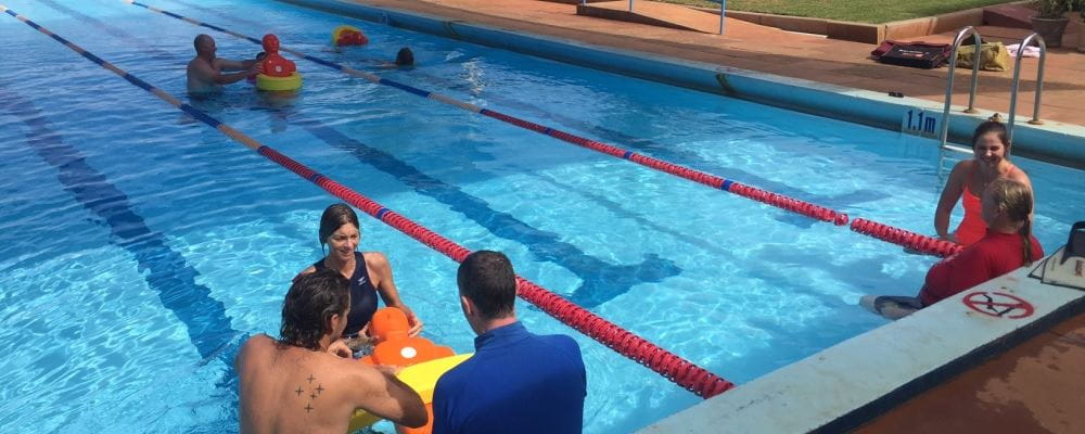 remote aboriginal swimming pool managers practising pool lifesaving skills