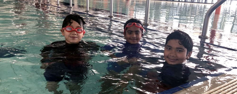 Three multicultural boys in the pool at Cannington