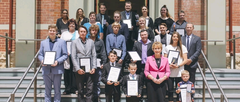 Winners of the Royal Life Saving Bravery Awards on the steps of Government House